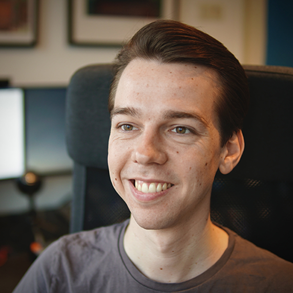 A headshot of an insanely handsome developer looking just past the camera with a strapping smile.